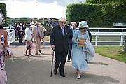 DUKE OF RICHMOND; DUCHESS OF RICHMOND, Glorious Goodwood. Sussex. 28 July 2010, -DO NOT ARCHIVE-© Copyright Photograph by Dafydd Jones. 248 Clapham Rd. London SW9 0PZ. Tel 0207 820 0771. www.dafjones.com.