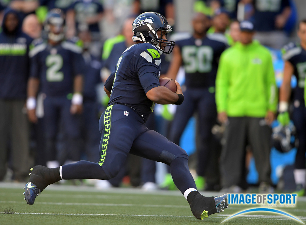 Sep 11, 2016; Seattle, WA, USA; Seattle Seahawks quarterback Russell Wilson (3) carries the ball in the fourth quarter against the Miami Dolphins during a NFL game at CenturyLink Field. The Seahawks defeated the Dolphins 12-10.