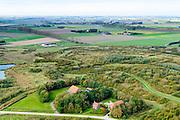 Nederland, Zeeland, Gemeente Terneuzen, 19-10-2014; Braakman en Braakmanpolder , voormalige zeearm.  Westerschelde aan de horizon. Boerderijen in wederopbouw stijl.<br /> Nature reserve Braakman polder, a former estuary.<br /> luchtfoto (toeslag op standard tarieven);<br /> aerial photo (additional fee required);<br /> copyright foto/photo Siebe Swart