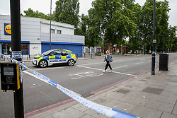 © Licensed to London News Pictures. 09/07/2019. London, UK. Crime scene on Seven Sisters Road in Finsbury Park, north London following a stabbing at about 9.45pm on Monday 8 July 2019. Police officers found a 30 years old man suffering a knife wound and a second man, believed to be in his late twenties, was discovered with a gunshot injury in the nearby Blackstock Road. According to the police, the stab victim is in a stable condition. Photo credit: Dinendra Haria/LNP