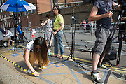 London, UK. Monday 22nd July 2013. A Chinese tv company tapes down their position. Media frenzy outside St Mary's Hospital in London on the day that Kate Middleton Duchess of Cambridge was taken into hospital after going into labour. Immediately the global media village began to buzz with activity and the Royalist public started to arrive in numbers.