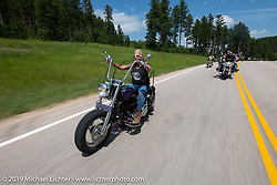 Photographer Melissa Missi Shoemaker on her Evo chopper on the Cycle Source Ride up Vanocker Canyon to Nemo during the Sturgis Black Hills Motorcycle Rally. SD, USA. Wednesday, August 7, 2019. Photography ©2019 Michael Lichter.