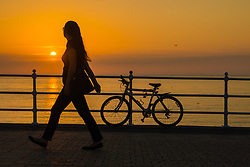 © Licensed to London News Pictures. 06/06/2018. Aberystwyth, UK. Sunset over the seaside pier in Aberystwyth on the Cardigan Bay coast of west Wales. Photo credit: Keith Morris/LNP