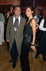 CARLOS MOTA and ALISON SAROFIM at a party hosted by Elizabeth Saltzman and Harvey Nichols to celebrate the UK launch of New York fashion designer Tory Burch held at the Fifth Floor Restaurant, Harvey Nichols, Knightsbridge, London on 24th May 2006.<br /><br />NON EXCLUSIVE - WORLD RIGHTS