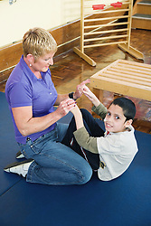 Boy with cerebral palsy doing exercises,