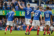 Portsmouth Players Celebrate after Portsmouth Forward, Oliver Hawkins (9) scores his second goal to make it 2-0 during the EFL Sky Bet League 1 match between Portsmouth and Milton Keynes Dons at Fratton Park, Portsmouth, England on 14 October 2017. Photo by Adam Rivers.