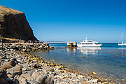 Visitors prepare to board the Island Packers' ferry to return to the mainland, Scorpion Anchorage, Santa Cruz Island, Channel Islands National Park, California, USA.