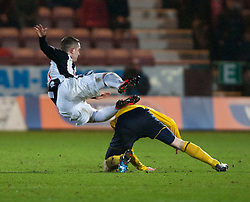 Dunfermline's Ryan Wallace tackled by Falkirk's Blair Alston..Dunfermline 0 v 1 Falkirk, 26/12/2012..©Michael Schofield.