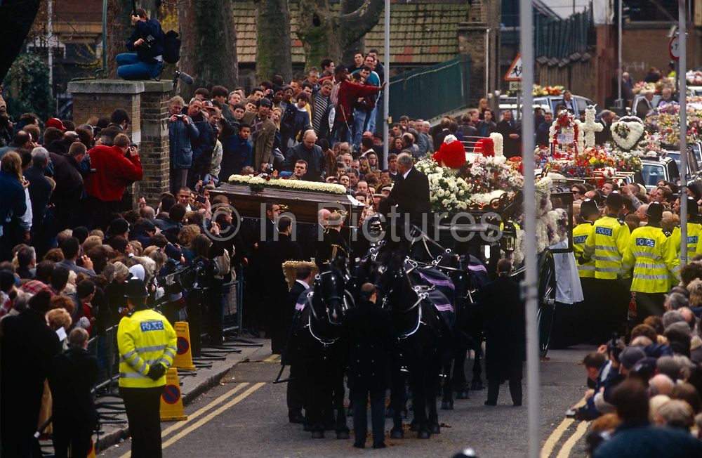 East End crowds flock at the funeral of notorious gangland brother Ronnie Kray, on 29th March 1995, in Bethnal Green, East London, England.