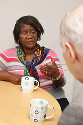 Carer and pensioner talking.