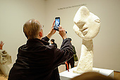 Picasso sculpture and museum visitors at MoMA