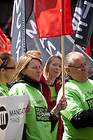 Dunnes Stores workers and supporters protest over working conditions, including low-hour contracts, at a rally outside the head office of the Dunnes Stores in Georges Street, Dublin on Saturday 6th June 2015.