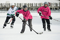 The Shore Shots and Joe's Chicks hit the ice for first round Women's Division action at the New England Pond Hockey Classic at Meredith Bay Friday morning.  (Karen Bobotas/for the Laconia Daily Sun)