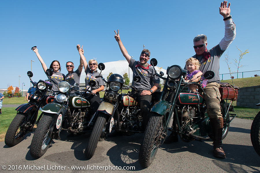 """Team Vino with Olivia Jacobs, Scott Jacobs, Sharon Jacobs, Robert Gustavsson (""""Big Swede"""") and Dean Bordigioni celebrate after crossing the finish line at the end of Stage 16 (142 miles) of the Motorcycle Cannonball Cross-Country Endurance Run, which on this day ran from Yakima to Tacoma, WA, USA. Sunday, September 21, 2014.  Photography ©2014 Michael Lichter."""