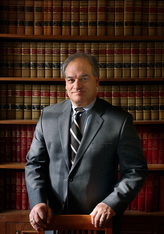 Biz12/28/04  Photo by Mara Lavitt--Ray Garcia<br /> ML0162F<br /> Attorney Ray Garcia in his New Haven office.