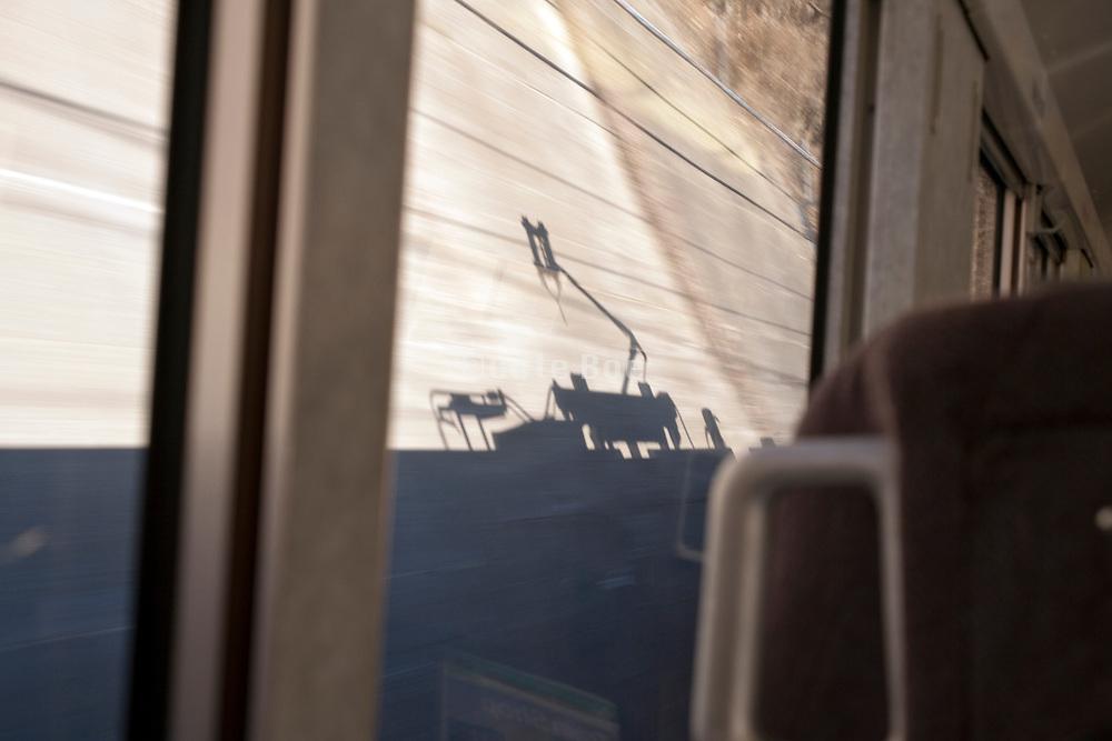 train pantograph shadow while riding