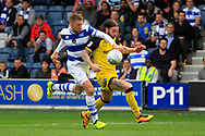 Queens Park Rangers striker Jamie Mackie (12) tussles for the ball with Burton Albion defender John Brayford (2) during the EFL Sky Bet Championship match between Queens Park Rangers and Burton Albion at the Loftus Road Stadium, London, England on 23 September 2017. Photo by Richard Holmes.