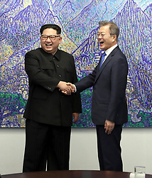 April 27, 2018 - Paju, South Korea - South Korean President MOON JAE-IN and North Korean leader KIM JONG-UN during their inter-Korean summit at the Panmunjom in the demilitarized zone (DMZ) separating the two Koreas in Paju, north of Seoul, South Korea. (Credit Image: © Inter-Korean Press Corps via ZUMA Wire)