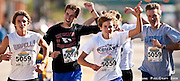 Team Moser: Larry, Grant, Lane, Bennet, and Chase Moser triumphantly approach the finish line with a time of 2:38:21 in the 5-Person Team Relay of the Quad Cities Marathon.