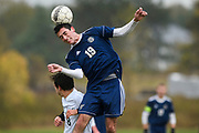 Essex's Spencer Towle (19) leaps over Rice's Elliot Limanek (8) to head the ball during the boys soccer play down game between the Rice Green knights and the Essex Hornets at Essex High School on Tuesday afternoon October 23, 2018 in Essex. (BRIAN JENKINS/for the FREE PRESS)