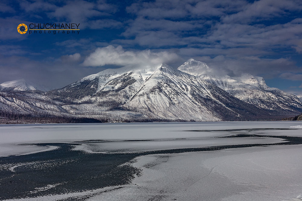 Stanton Mountain and Mt Vaught above wintry Lake McDonald in Glacier National Park, Montana, USA