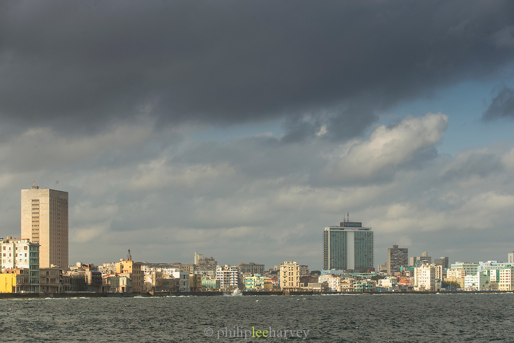 Cityscape under storm clouds across the bay, Havana, Cuba
