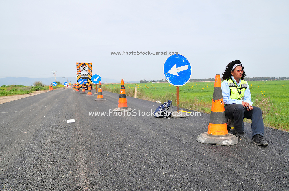 Road Works Ahead - a traffic lane is closed due to maintenance work