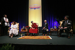 17 May 2013. New Orleans, Louisiana,  USA..His Holiness the 14th Dalai Lama jokes with Dr Ronald Marks, Dean of Tulane University School of Social Science (l), with Dr Margaret Wheatley and Dr Richard Davidson (rt) at the Morial Convention Center . The Dalai Lama is in New Orleans for the 'Resiliance - Strength through Compassion and Connection' conference. .Photo; Charlie Varley.