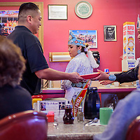 020715       Cable Hoover<br /> <br /> Miss Indian Farmington Shenoa Jones, center, and MIss Alamo Tierra Apachito help serve customers during the Tip A Royalty fundraiser at Earl's Restaurant in Gallup Saturday.