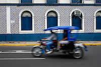 IQUITOS, PERU - CIRCA OCTOBER 2015:  Typical motorbike in Iquitos, a city in the Peruvian Amazon.