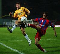 Photo. Daniel Hambury.<br /> UEFA Cup.<br /> Panionios V Newcastle United. 21/10/2004.<br /> Panionios' Spiropoulos and Newcastle's James Milner