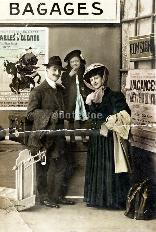 studio portrait of traveling people at the train station vintage scene