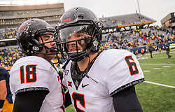 Nov 23, 2019; Morgantown, WV, USA; Oklahoma State Cowboys quarterback Dru Brown (6) celebrates with teammates after defeating the West Virginia Mountaineers at Mountaineer Field at Milan Puskar Stadium. Mandatory Credit: Ben Queen-USA TODAY Sports