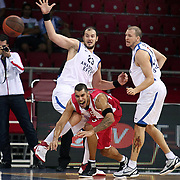 Anadolu Efes's Ermal KURTOGLU (L) and Olympiacos's Georgios PRINTEZIS (C) during their Two Nations Cup basketball match Anadolu Efes between Olympiacos at Abdi Ipekci Arena in Istanbul Turkey on Sunday 02 October 2011. Photo by TURKPIX