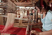 Mar. 14, 2009 -- LUANG PRABANG, LAOS: A woman works a loom in a women's weaving cooperative in Luang Prabang, Laos.  Photo by Jack Kurtz / ZUMA Press