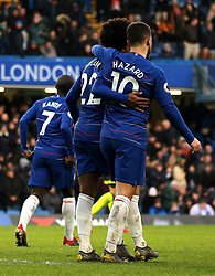 Chelsea's Eden Hazard (right) celebrates scoring his side's third goal of the game with team mates