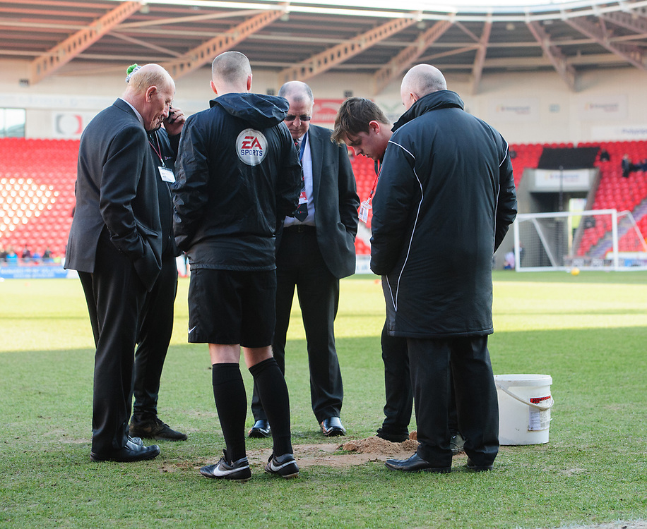 A member of the Doncaster Rovers ground staff repairs a hold in the Keepmoat Stadium pitch prior to the pre-match warm-up<br /> <br /> Photographer Chris Vaughan/CameraSport<br /> <br /> The EFL Sky Bet League One - Doncaster Rovers v Fleetwood Town - Saturday 17th February 2018 - Keepmoat Stadium - Doncaster<br /> <br /> World Copyright © 2018 CameraSport. All rights reserved. 43 Linden Ave. Countesthorpe. Leicester. England. LE8 5PG - Tel: +44 (0) 116 277 4147 - admin@camerasport.com - www.camerasport.com