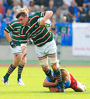 Photo: Henry Browne.<br /> Stade Francais v Leicester Tigers. Heineken Cup.<br /> 29/10/2005.<br /> Martin Corry of Tigers is tackled by Dimitri Szarzewski of Stade.