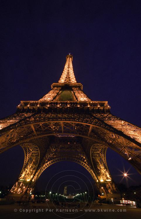 Eiffel Tower illuminated at night. Paris, France.