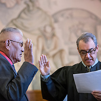 123014       Adron Gardner<br /> <br /> Charlie Long Sr., left, is sworn in as probate judge by Eleventh Judicial Court Judge Louis DePauli at the McKinley County Courthouse in Gallup Tuesday.