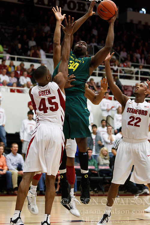 January 27, 2011; Stanford, CA, USA;  Oregon Ducks forward Joevan Catron (34) shoots over Stanford Cardinal guard Jeremy Green (45) during the first half at Maples Pavilion.