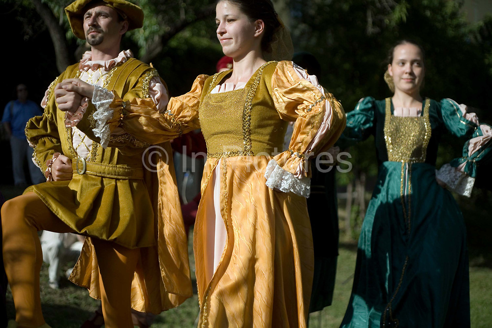 Dancers in traditional Hungarian folk costume perform at a cultural festival in Pec, Hungary.Pecs has been chosen as the 2010 European City of Culture. The city is on the southern slopes of the Mecsek Hills and has a sub-Mediterranean climate. Settled by Romans as Sopianae, it was a significant Christian settlement. Later conquered by the Ottomans, it has important Turkish architecture.