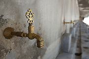 """A row of water faucets at The Sultan Ahmed Mosque or popularly known as """"The Blue Mosque"""" for the blue tiles on the walls and ceilings of the enormous mosque completed in 1616 in Istanbul, Turkey.  Photo and all rights reserved, Bryan Rinnert/3Sight Photography."""