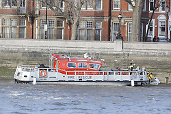 CAPTION CORRECTION © Licensed to London News Pictures. 14/12/2019. London, UK. A Fire & Rescue boat is seen on The River Thames near The Thames Tideway sewer works on Chelsea Embankment shortly before a controlled explosion was carried out on a WW2 unexploded bomb.  Photo credit: Peter Macdiarmid/LNP