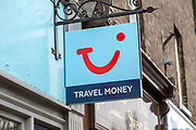 TUI travel money currency exchange sign outside High Street shop, UK