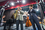 Jazz musician Don Braden, left, performs with members of the Los Angeles County High School for the Arts Jazz Quartet, Julian Gomez, center, and Evan Abounassar, right, during a program sponsored by the Thelonius Monk Institute at Waltrip High School, February 29, 2016.