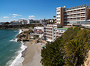 Playa Caletilla sandy beach at popular holiday resort town of Nerja, Malaga province, Spain