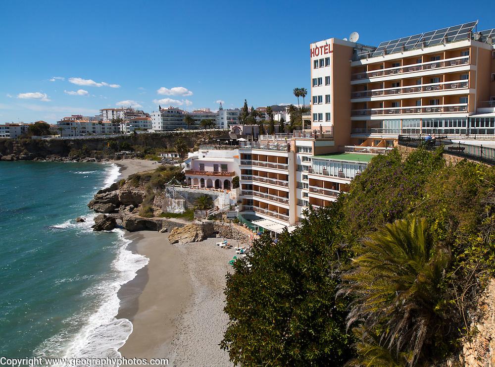 Playa Caletilla sandy beach at popular holiday resort town of Nerja, Malaga province, Spain