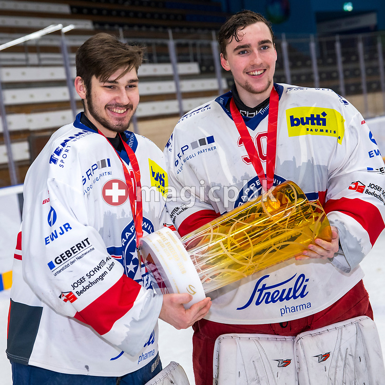 (L-R) Rapperswil-Jona Lakers goaltenders Gian-Marco Bamert and Beat Trudel pose for a photo with the Swiss Champion trophy after winning ice hockey game 4 of the Elite B Playoff Final between EHC Chur Capricorns and Rapperswil-Jona Lakers in Chur, Switzerland, Friday, March 16, 2018. (Photo by Patrick B. Kraemer / MAGICPBK)