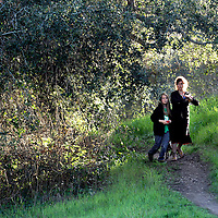 Nicole Galasso enjoys a late afternoon walk with her son Ty on the Lower Meadow Trail in the Pogonip green belt in Santa Cruz, California.<br /> Photo by Shmuel Thaler <br /> shmuel_thaler@yahoo.com www.shmuelthaler.com